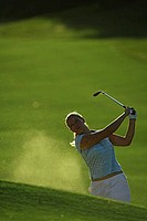 Female Golfer Making a Chip Shot