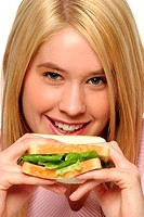 A blonde hair girl holding up a sandwich close to her face
