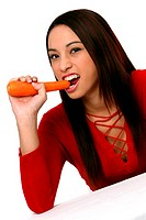 A woman in red blouse biting a carrot