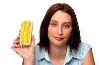 A woman holding up a cut maize