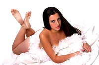 A topless woman lying forward with white feathers covering her breasts