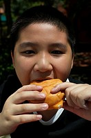 Boy eating bun (thumbnail)