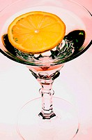 A slice of orange in a glass of drink