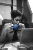 Businesswoman drinking a cup of coffee.