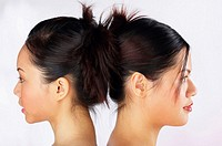 Side shot of two women's face