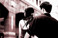 Back shot of couple walking together