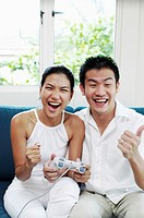 Couple playing video game console