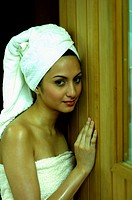 Woman in towel having steam bath