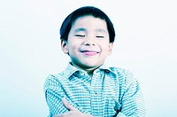 Boy flashing a big bright smile at the camera