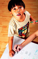 Boy drawing pictures.