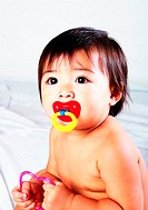 Baby girl sucking pacifier