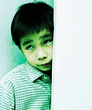 Boy hiding behind the door