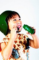 Boy in soldier outfit drinking water