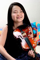 Girl practising violin