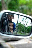 Boys travelling in a car