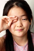Girl rubbing her eye