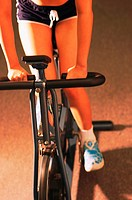 Woman cycling (thumbnail)