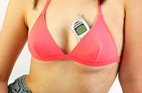 Woman keeping her mobile phone inside the bra