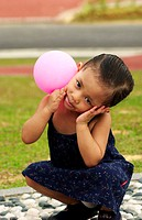 Girl holding a pink balloon