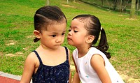 Girl kissing her sister