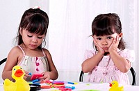 Girls playing with educational toy
