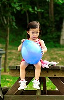 Girl holding a balloon