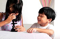 Boy and girl using microscope