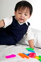 Boy playing with educational toy
