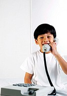 Boy talking on the phone