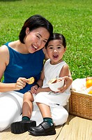 Mother and daughter picnicking (thumbnail)