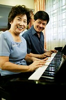 Couple playing piano