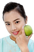 Woman holding a green apple.