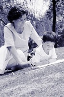 Woman watching her grandson drawing