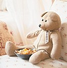 View of teddy bear on couch, close_up