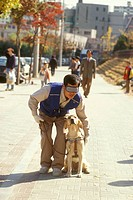 Korea-Guide-Dog-Training/nw/-handler-on-street
