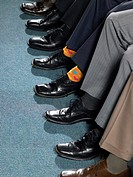 Businessman sitting in a row (thumbnail)