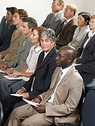 Office workers listening to a presentation
