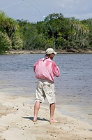 Man fishing on river, casting rod