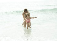 Mother and daughter in water at beach