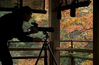 Photographer photographs fall colour, Kyoto, Honshu, Japan