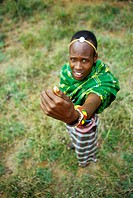 Traditional woundcare. Samburu man from Kenya showing how an insect has been used to treat a cut on his hand. The cut is on the right side of his hand...