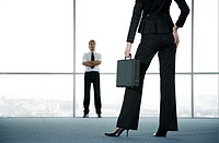 Businessman and businesswoman.
