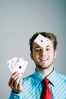 Businessman playing with cards