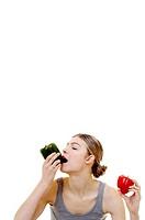 Woman eating capsicum.
