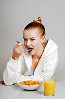 Woman having breakfast cereal.