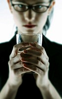 Businesswoman holding a glass of water.