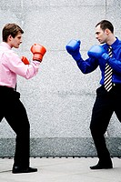 Businessmen with boxing gloves getting ready to fight