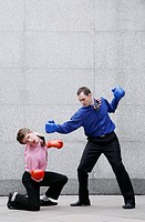 Businessmen in boxing gloves fighting