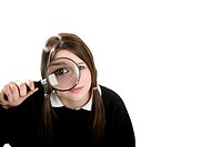 Girl using magnifying glass.