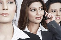 Close-up of three businesswomen looking away